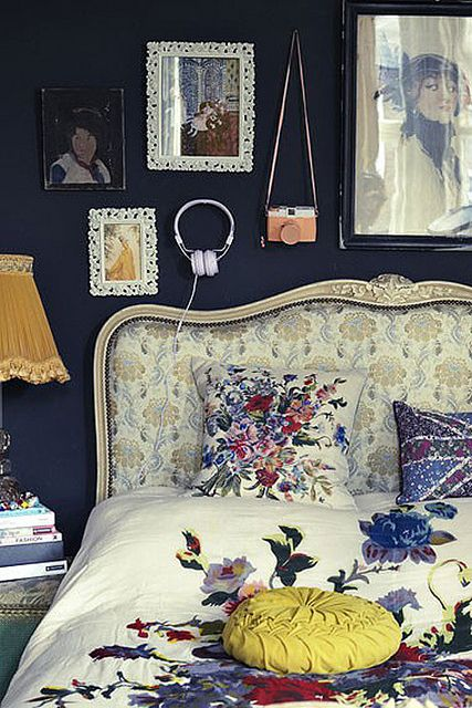 Moody blues, antique florals and eclectic artwork make this room truly unique.