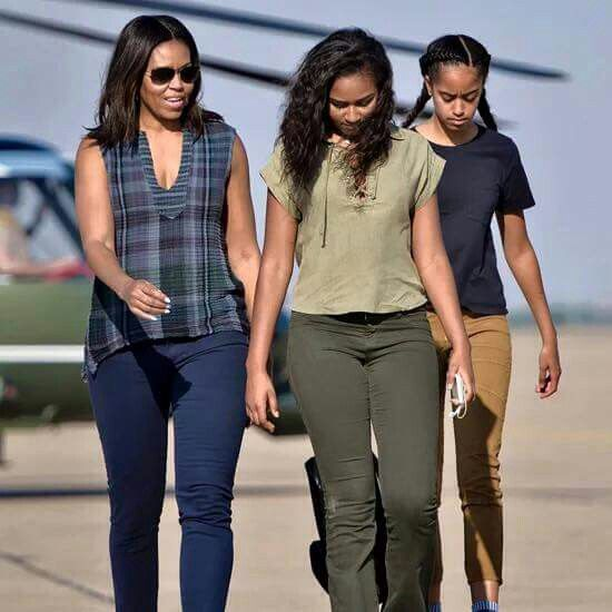 First Lady Michelle Obama and her daughters.