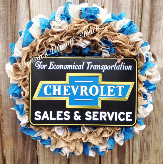 """Business Wreath for Chevrolet Dealership made with aqua, beige and plain burlap using the ruffle technique on an 18"""" wire frame."""