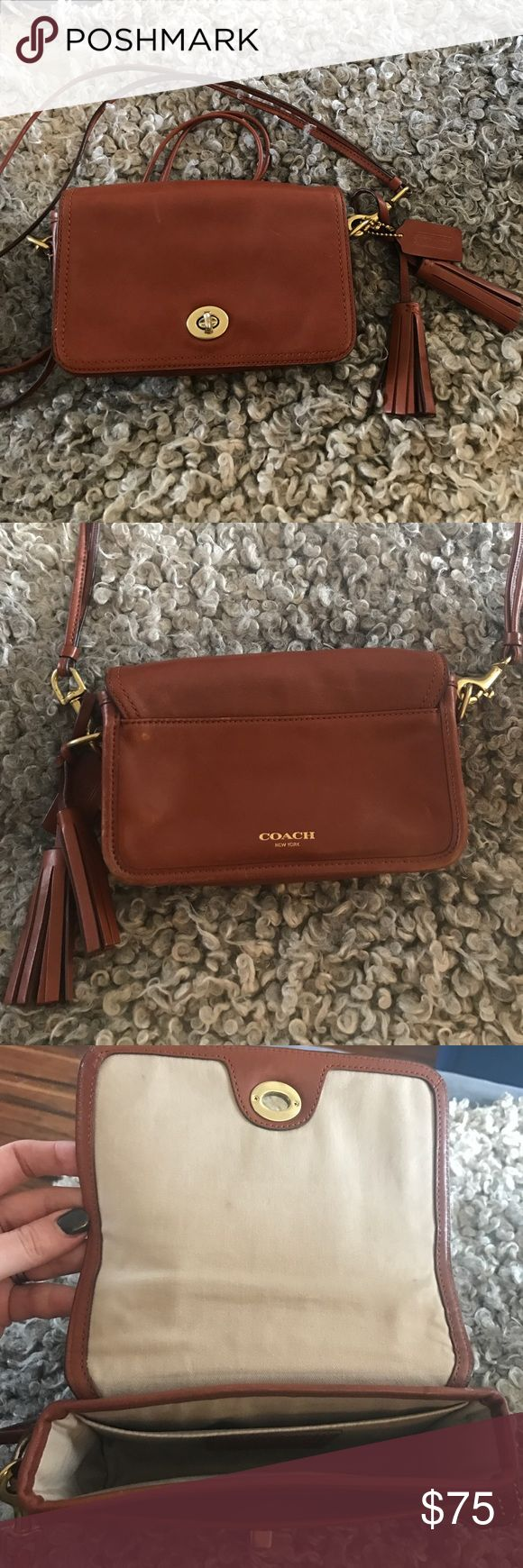Coach Legacy Penny Bag Beautiful little bag. A little wear and tear on the  hardware and minor scuffs on the leather. Cute leather tassels. Double the straps to wear it short, remove the straps to wear as a clutch. Very versatile. It's in overall good condition Coach Bags Crossbody Bags