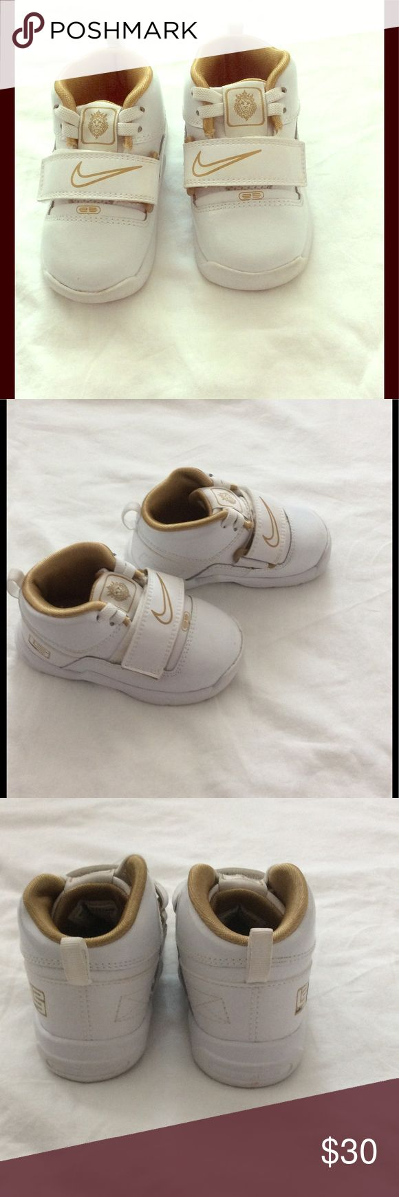 Lebron baby Nike shoes. Like new baby Nike shoes in size 5. White and gold color. Nike Shoes Sneakers