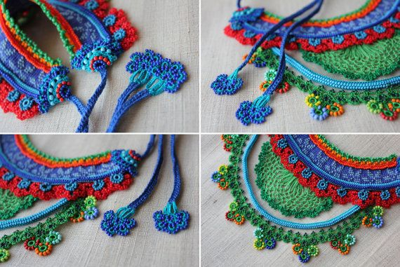Colorful statement necklace is decorated with beaded crochet flowers and decorations in crimson red, orange, indigo blue, cornflower blue, turquoise blue, kelly green tones.  Base of the bib necklace is created with red, sapphire blue and cornflower blue cotton fibers. We decorated the necklace with glass seed beads, organic forms, beaded crochet flowers in orange, lobster red, lime green, turquoise blue, indigo blue, teal blue, crimson red and paris green tones. It is decorated with a half…