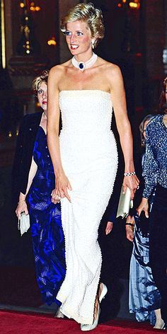 Diana gave a glimpse of the '90s style she would embrace (bold colors, body-conscious silhouettes and shorter locks) at a 1990 event in Hungary. This is her Catherine Walker designed suit dress that she named the 'Elvis' dress, due to the high collar jacket it came with. Here she wears the strapless gown without the jacket.