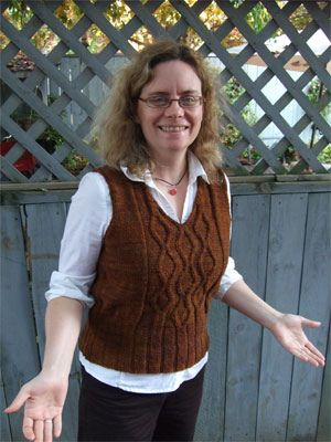 """Diamond Rain by Sandi Luck  it's a vest. it has yarnharlot wearing it (who commented it was a """"fun, quick knit""""). it has textural goodness going on. and it's a cormo yarn, which gives you a good idea of the results you're going to get. what's not to love?"""