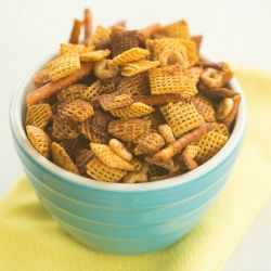 Best Homemade Chex Mix Recipe | Brown Eyed Baker  I love to add hot sauce to the butter mixture for a spicy version of this classic.