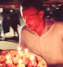 Blowing out the candles on his birthday cupcakes._GIF