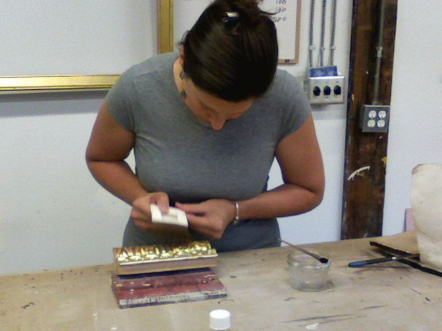 Laying 23kt gold leaf for her first time.