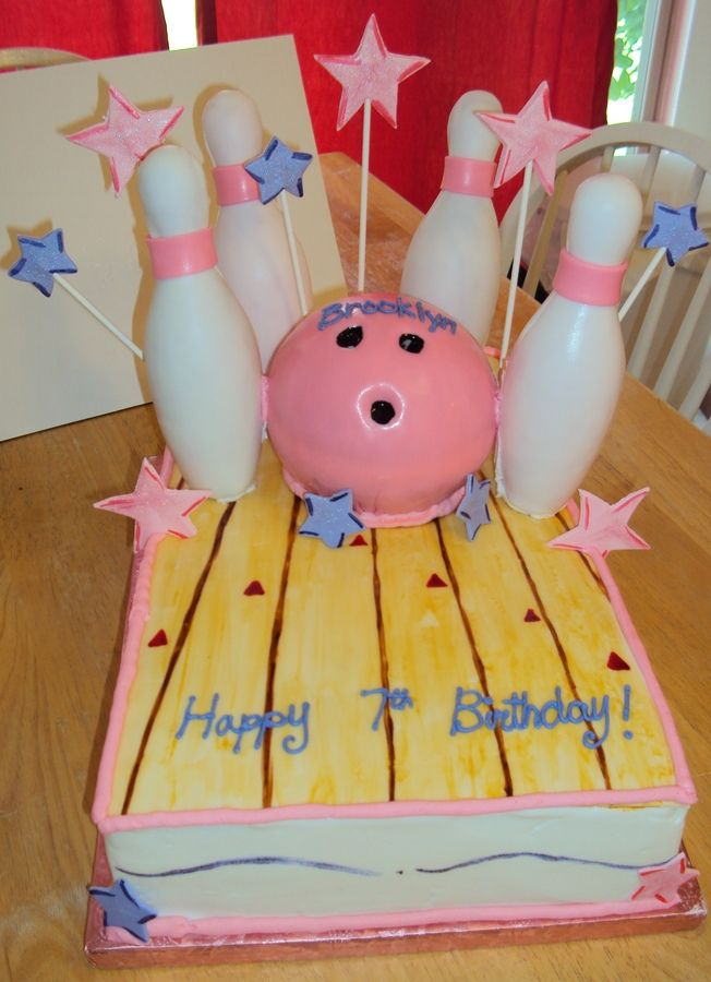 I made this for a little girl turning 7. She was having her party at a local bowling alley. It is a 3 layer chocolate cake covered in butter cream. The ball is a white cake covered in pink fondant. The floor of the alley was a thin strip of fondant that I painted with cake coloring and vodka. It turned out really nice. The pins are wrapped in fondant (I cheated on the pins ha). The stars are gumpaste. Enjoy.