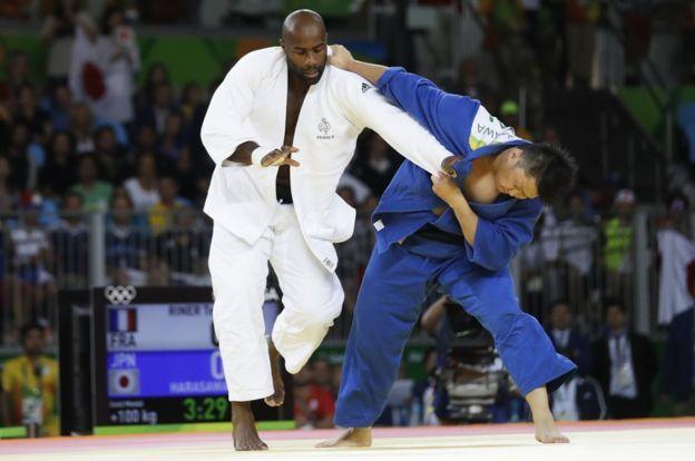France's Teddy Riner (left) beats Japan's Hisayoshi Harasawa in the final of the +100kg. judo at Rio 2016
