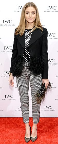 Olivia Palermo wears a Tibi cropped sweater, checked pants and an Emporio Armani jacket to the Tribeca Film Festival
