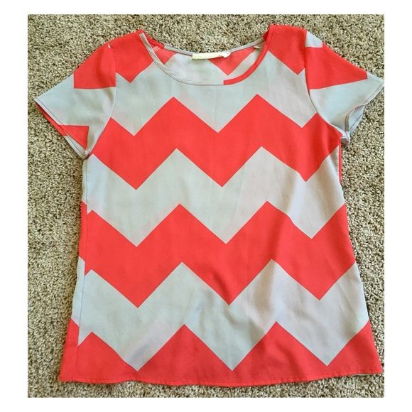 FRIDAY SALE | chevron blouse Super cute shirt! Colors are coral and grey. It has a cross/open back. It can be dressed up or down! I've only worn it once and it was purchased from a boutique. Feel free to make an offer!  Peach Love Cream Tops Blouses