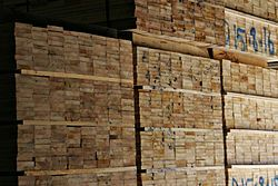 Lumber (American English)[1] or timber (British English, Hiberno-English, New Zealand English, and Australian English)[2] is wood that has been processed into beams and planks, a stage in the process of wood production.