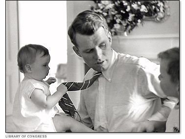 Robert Kennedy plays with two of his young children.