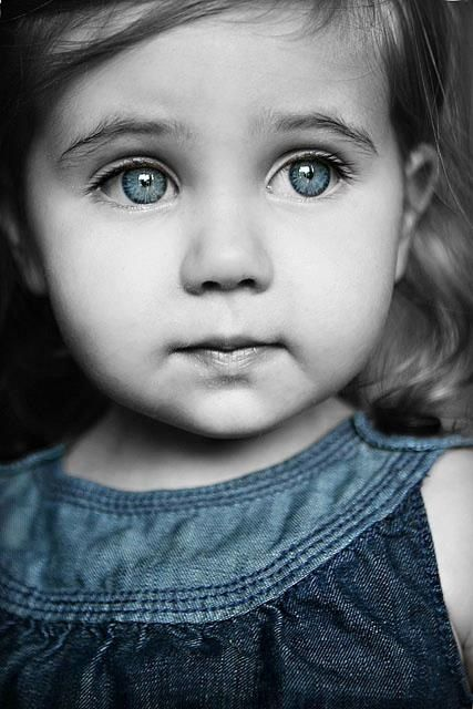 Black and white photography with splash of color so cute little girl in blue