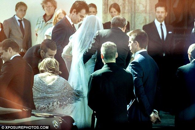 Barbosa arrives at her wedding all dressed in white ahead of her wedding to Mendes in Port...