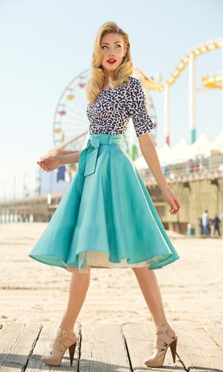 Retro (50's/60's) is always a GREAT option for an hourglass, and this outfit is no exception. The knee-length skirt is appropriate, but flattering. The printed top is simply cut, but also brings a note of complexity with the pattern. The bow decal on the tailored waist of the skirt is the icing on the cake, and sky-high nude heels help elongate your legs.