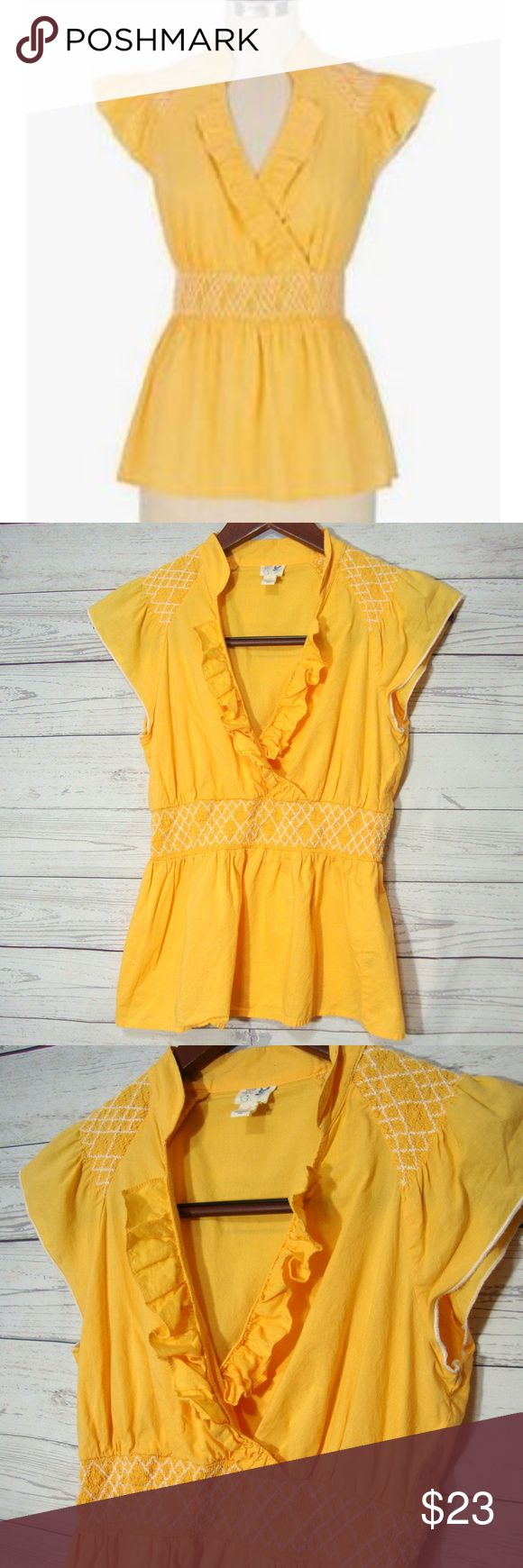 Edme & Esyllte Smocked Cotton Ruffle Top From Anthropologie's Edme &Esyllte line  Size 4  Laying flat it measures: underarm to underarm - 17 inches across from back of neck to bottom - 22 inches  Color: yellowish orange  Gently used  From a smoke free and pet friendly home Edme & Esyllte Orange Smocked Cotton Flutter Top 4 Ruffle Shirt Anthropologie Anthropologie Tops Blouses