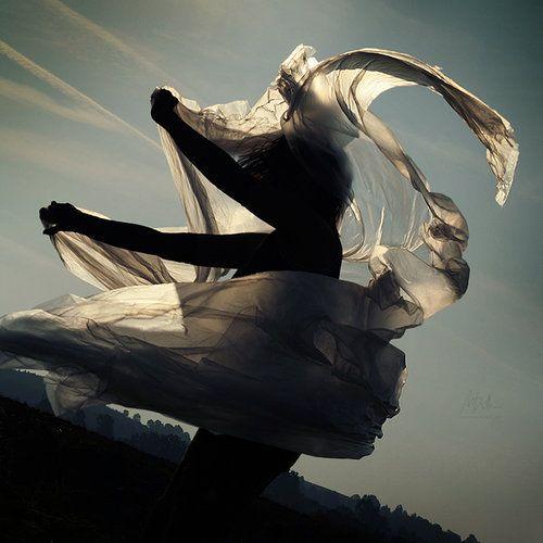 silhouette. cloth. wind. sky.