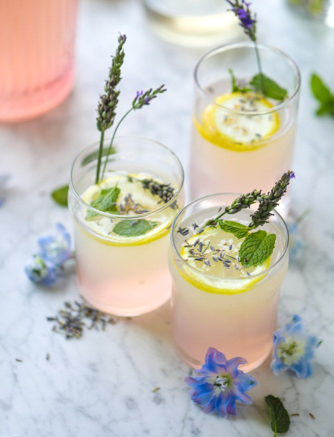 The most refreshing lavender lemonade recipe for summer made with lavender syrup, lots of juiced lemons and fresh mint! It's easy too!
