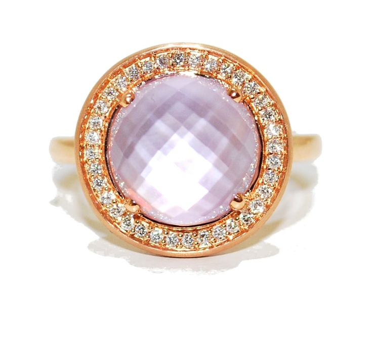 18ct rose gold ring with a beautiful multi faceted pink amethyst which is surrounded by a frosting of dazzling diamonds.  £932