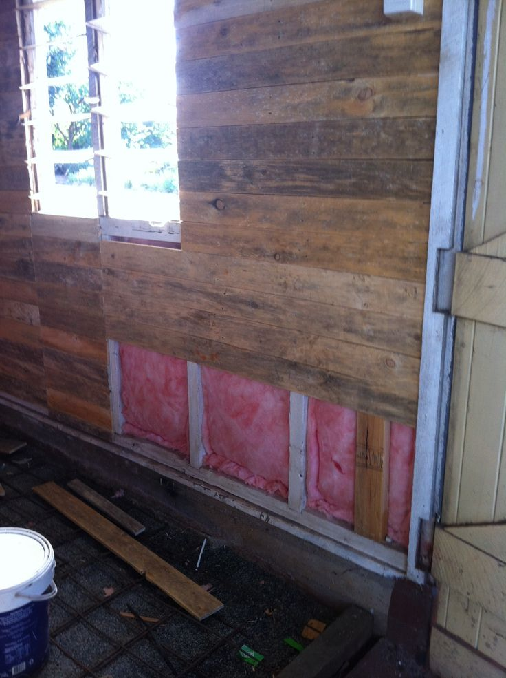 Pallet Shed Man Cave : Insulation bats and pallet boards going on the walls of
