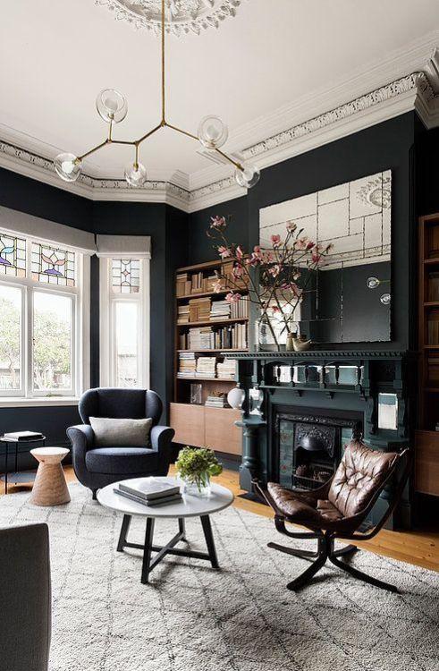 Black walls and classic architectural details. ##blackpaint #parisiandecor