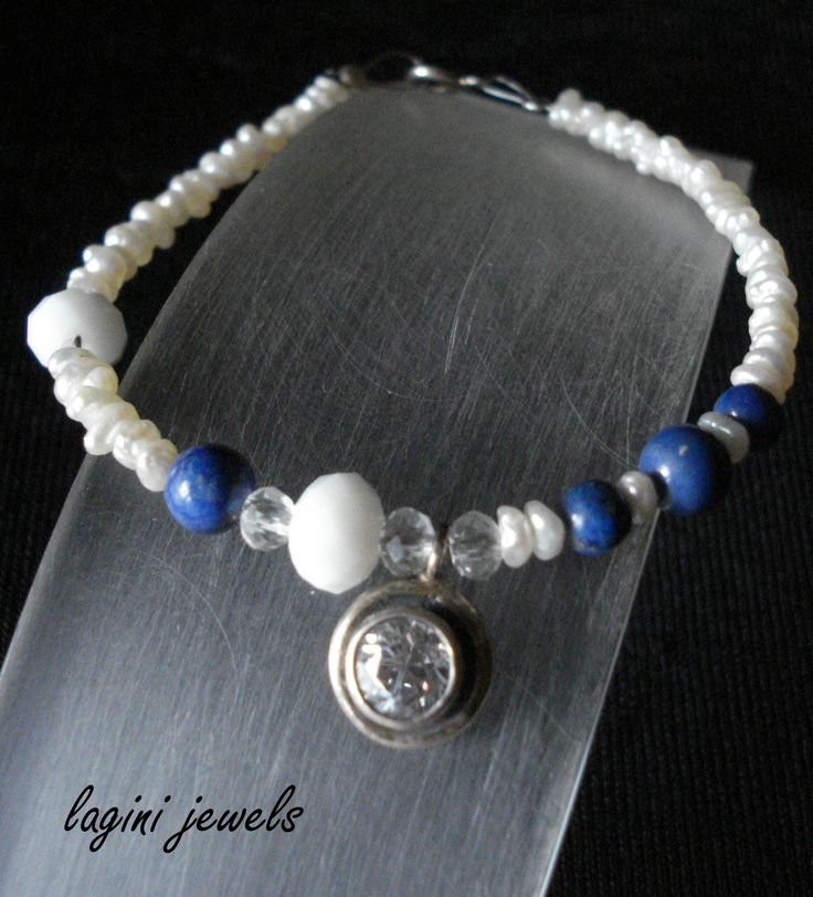 Hand made bracelet of silver 925,pearls,turquoise and crystal Made by  Eirini Svarnia Price 35,00 euro