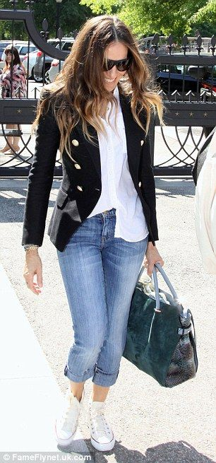 Effortless style: SJP teamed her smart navy blazer and tailored white blouse with turned up jeans and Converse trainers as she headed out and about in Washington on Tuesday