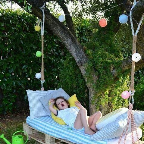 Awesome hanging day bed. I could just see the kids lounging on this in Spring and Summer. Actually I can see myself lounging on this instead. Love the check sheets and pillowcases.
