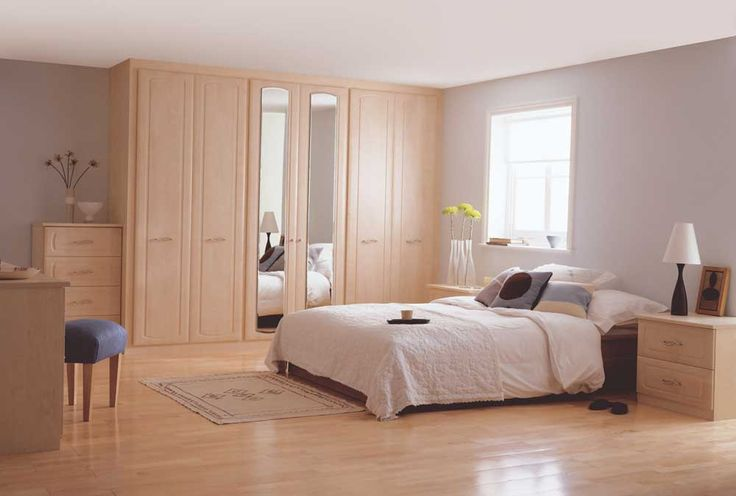 Bedroom Cupboard Design Ideas with soft brown mirror doors wardrobe and soft brown two drawers night stand also classic table lamp