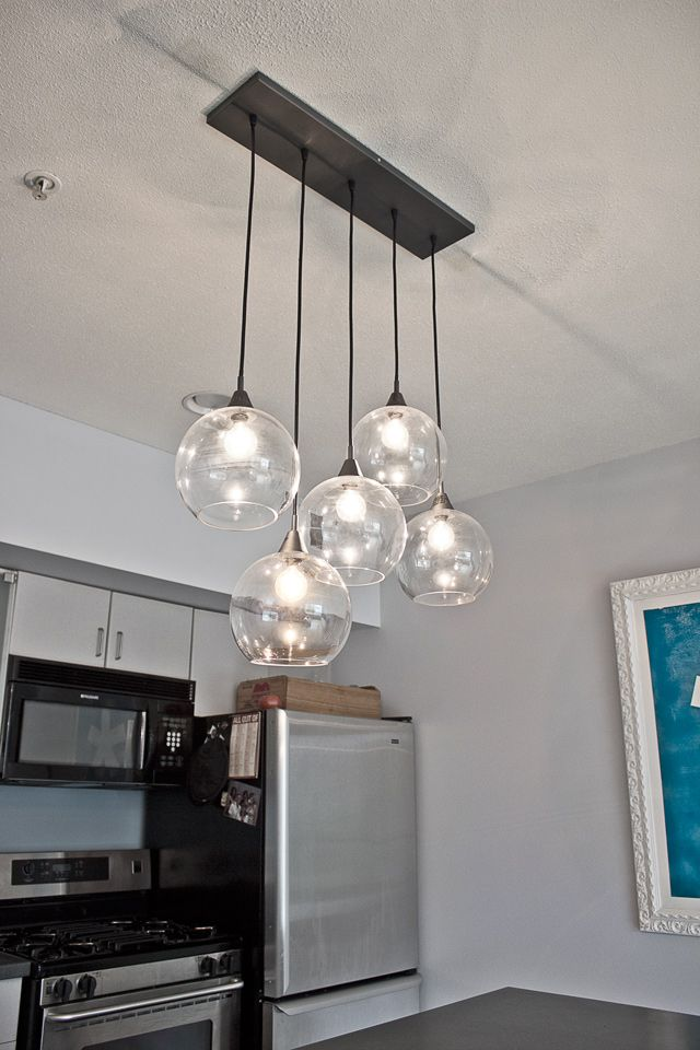 If you think back to our kitchen tour, you may remember the pendant light we had hanging above the kitchen island. It was blue and had three dangling lights. It was functional, but very bland. …