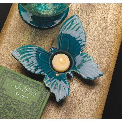 Butterfly Tea Light Candle Holder - Enjoy the summertime beauty of a magical butterfly for all eternity with this Butterfly Tea Light Candle Holder. A delicately detailed butterfly spreads its wings to create the perfect space for the candle of your choice.