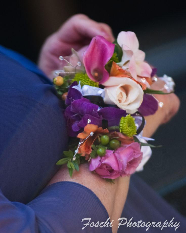 Vibrant summer tones create a wonderful wrist corsage for the mother of the groom.