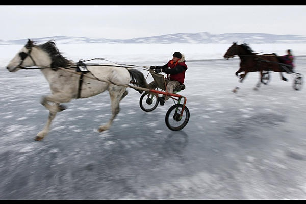 Trotters compete in a harness race on the frozen Yenisei river during the 43rd Ice Derby amateur horse race, near the settlement of Novosyolovo, about 155 miles south of the Siberian city of Krasnoyarsk.