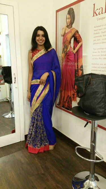 Now,that's something I can wear for a cocktail party.. love the colour.. the embroidery on the pleats gives enough detailing and love the red edging. Chiffon as it looks,is easily draped.the colour royal blue needs no accessories