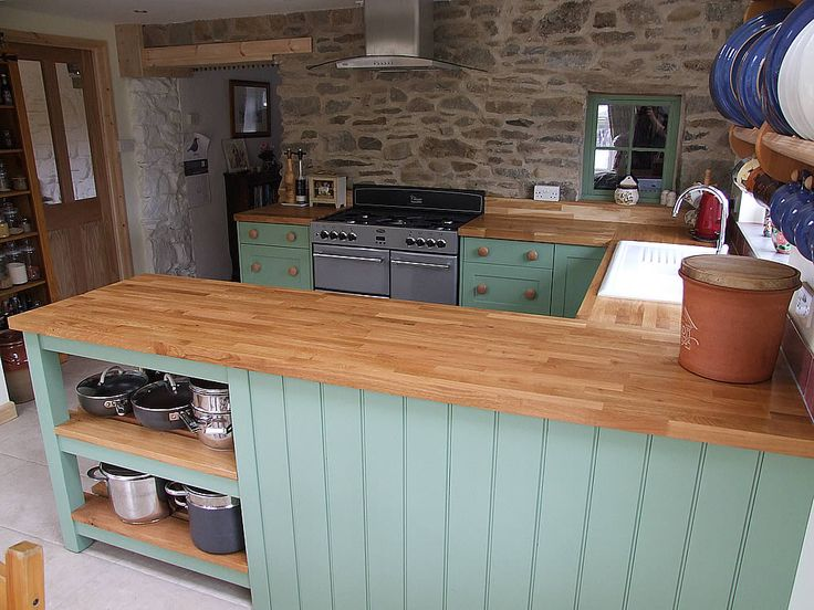 Shown here Hand-Painted in Farrow & Ball Breakfast Room Green this kitchen has an oiled butcher's block oak top fitted and incorporates a custom built oak-slatted potboard. See more here http://colinspicer.co.uk/painted-shaker-kitchens-wales