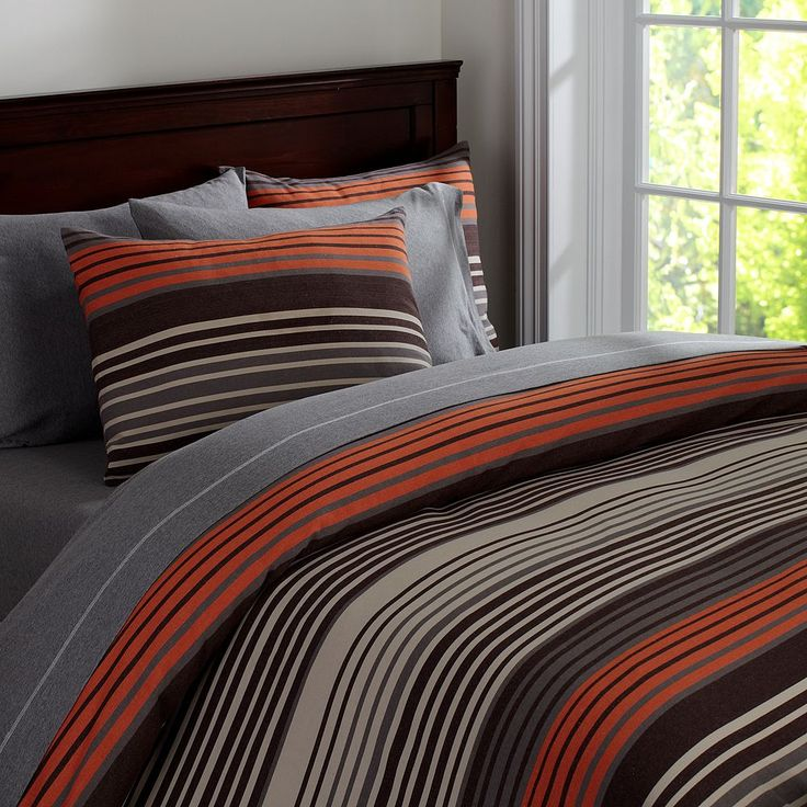 Teen Bedroom. Love the colors. Grey and white. With orange, brown, and blue accents. Keep room simple and open.