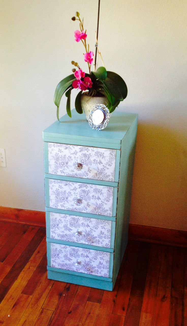 An old worn little chest of drawers brought back to life with chalk paint, antique floral paper decoupaged onto the drawers, distressed and finished off with round crystal handles. Stunning!
