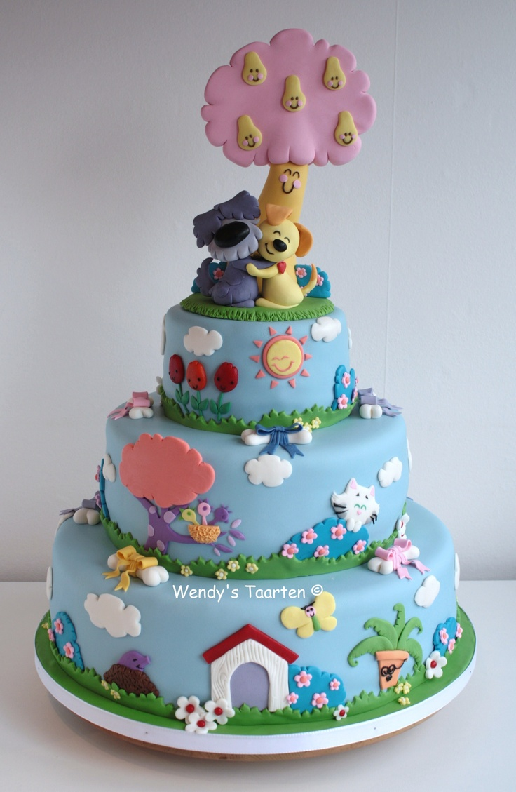 A cake for the opening of a theater show for children - The little dogs are woezel and pip and here in holland they are very popular in childrens books. Now they are in theater and for the opening I was asked to make the cake. All the characters on the cake were drawn in the books.