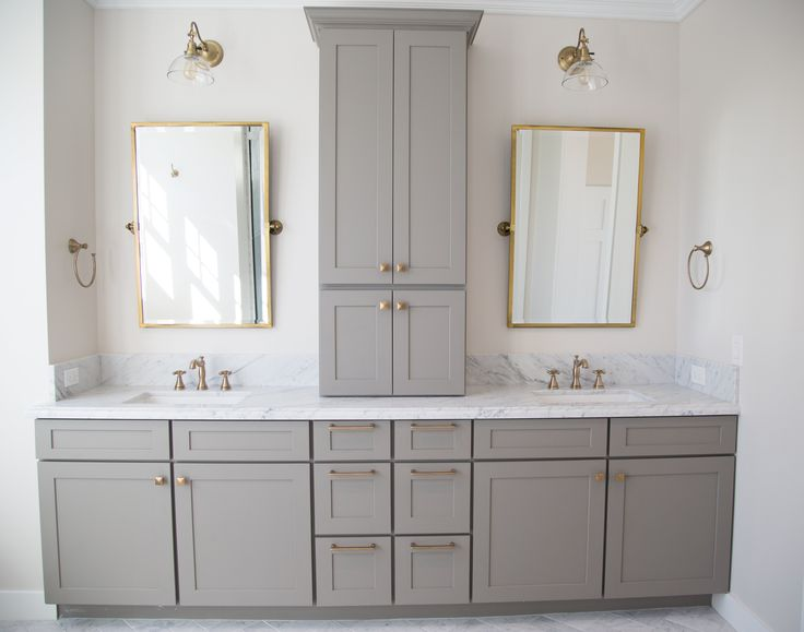 Carrara marble and grey master bathroom with antique brass accents by Rafterhouse.