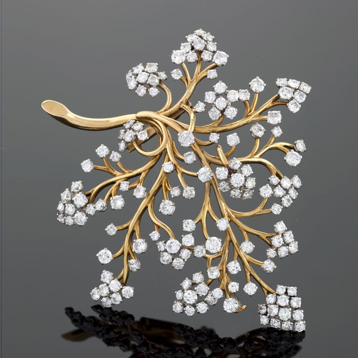 A French Mid 20th Century 18 karat gold and platinum brooch with diamonds by Van...