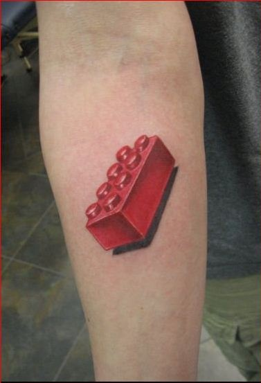 Lego tattoo by Eric Henry.