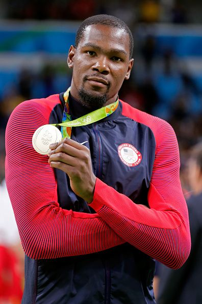 Gold medalist Kevin Durant of the United States celebrates after defeating…