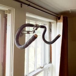 Cool simple DIY hanging bike rack made with a recycled pair of handle bars.