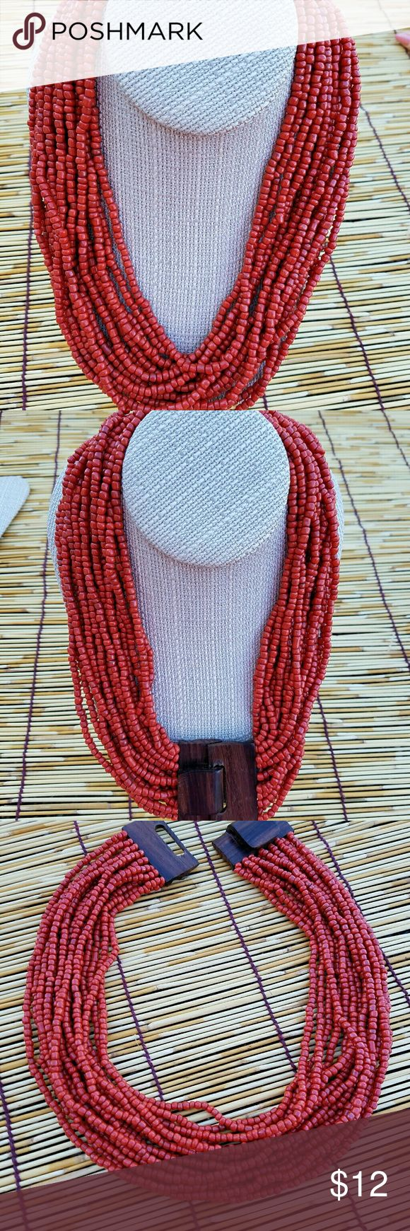 Orange India Bead Necklace Beads, beads, beads, 16 strands of bright orange beads from India, finished off with a hardwood grained clasp.  The length is 20 inches. There is no extention. Jewelry Necklaces