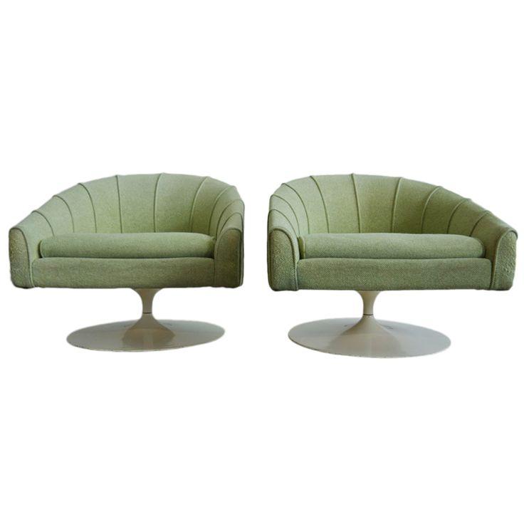 Pair of Jens Risom tulip base swivel lounge chairs