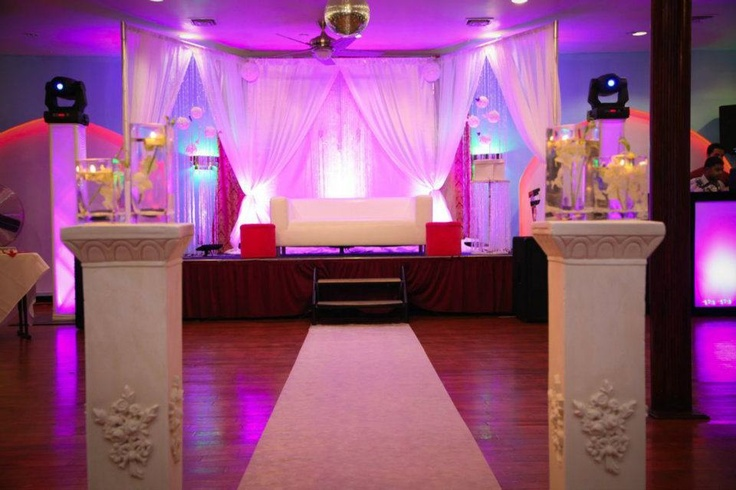 white stage with white couch and pillars