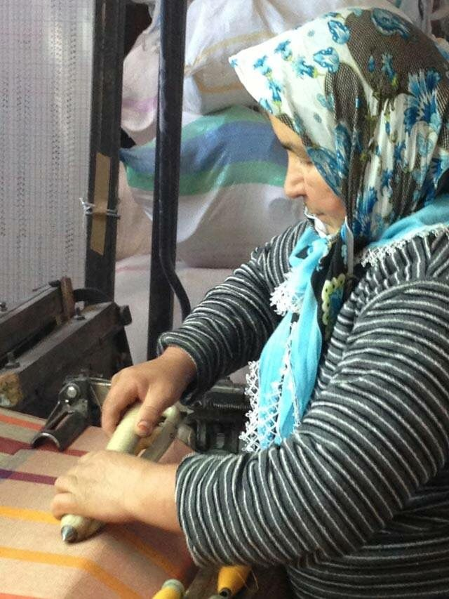 Commercial weaving in Turkey has always traditionally been men.  We lost our women weavers (AND TEACHERS) when they gave up their looms at home approx. 30 years ago.    This is Aunt Ayse, one of the few women commercial weavers left in Turkey.   She's making our rare 7 Wonder's Blanket. #Istanbul #women #Turkey #weaving #weaver #blanket #pestamel #towel #jennifershamam #organic #cotton