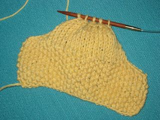Here is a pattern for easy-to-knit baby booties that I created for a charity project. This pattern was inspired by Bev's Stay-on Kni...