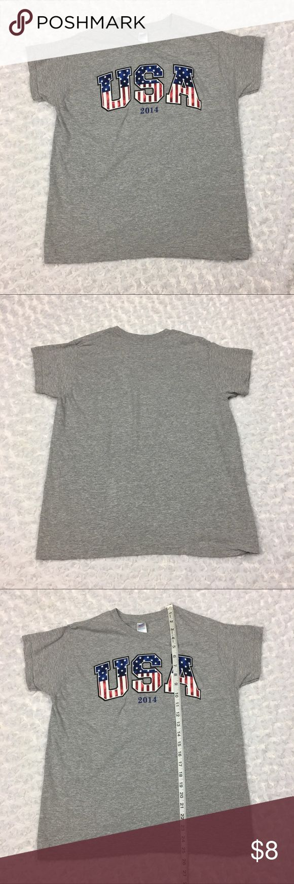 USA Year 2014 Graphic Gray Shortsleeve Tshirt Top Womens Large 12-14 USA Year 2014 Graphic Gray Grey Tshirt Top  Size: Womens Large 12/14. SEE PHOTOS FOR MEASUREMENTS  Condition: Gently used.  * This listing is for ONE (1) Top *   * See photos for measurements and more details *  Please note: Color may vary slightly due to different display screen calibrations.  [D-45] Made in USA Tops Tees - Short Sleeve